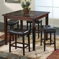 "Deland 5 Piece Dining Set by Welton USA. $538.57. F215-5E Features: -Material: Wood and wood veneers.-Transitional style.-With saddle seat design. Includes: -Set includes counter high table and 4 tufted stools. Options: -Stools are upholstered in a chocolate brown faux leather PVC with button tufting. Color/Finish: -Espresso finish.-Counter height table has 4 inlaid slate tiles and exposedmortise and tendon joint accents. Dimensions: -Tabe Dimensions: 36"" H x 42"" W x 42"" D.-Stoo..."