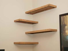 Image result for floating shelves in corner of wall in stairway