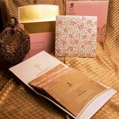 Lotus Jaal on baby pink metallic paper printed with pastel pink and gold shades. Jaal is printed and embossed on envelope and folder. Inserts with gold and pink papers give royal look