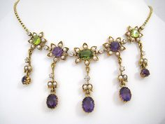 Edwardian Peridot, Amethyst, Diamond and Pearl Suffragette Necklace in 15k yellow gold (4NY) - $2,600  www.FancyFleaAntiques.com