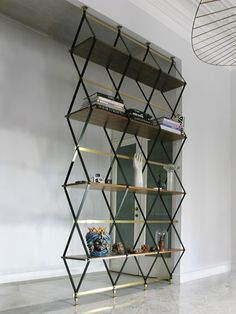 Italian designer Pietro Russo's furniture deserves as much attention as any unique and imaginative creation does. Whether it's a shelving system, table or lamp, the timeless gold with black accents create a luxurious yet sleek appearance. The modular structure reflects a futuristic sense of style that isn't too overstated, but still ingenious in design.