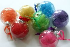 Tulle Rainbow Ornaments   Community Post: 39 Ways To Decorate A Glass Ornament Might be an idea to use somehow for decorations