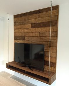 Floating Entertainment Unit With Wood Wall