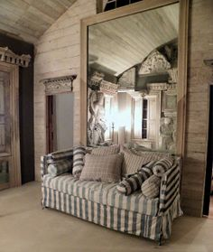 Bronson Pinchot's home...love the layers of bleached wood walls, mirrors, molding, etc.