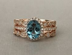 This listing is for an Oval Cut Natural London Blue Topaz Simulated Diamond Stone Rose Gold Sterling silver ring Set *********product Description********* This beautiful Oval Natural London Blue Topaz stone measure 6mms by 8mms The Accent Stones Are Round Simulated Diamonds The Face