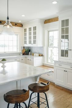 Beautiful wood & white kitchen. Love the window seat if we have to keep that window the same in the kitchen.