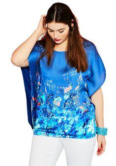 Blaues sheego Shirt mit Fledermausärmeln in Seidenoptik.