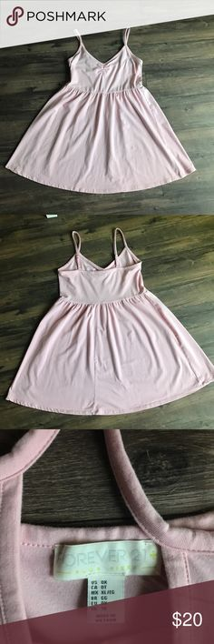Bubblegum Pink Tank Mini Dress Never worn!! Only tried on for this picture and changed my mind after I had already taken off the Tags. Very comfortable and flattering. Forever 21 Dresses Mini