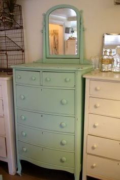 Love the colour and the height of this pale green dresser.