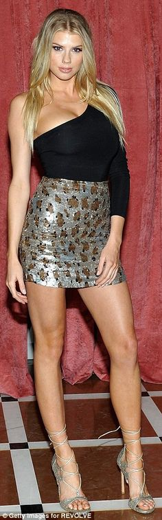 Model material: Charlotte McKinney, 23, flaunted her sensational figure  in a sequin mini skirt as she made her arrival at the Revolve Winter Formal Party in LA on Thursday