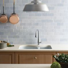 """Blue Celeste 3"""" x 6"""" marble field in honed finish with KOHLER Lawnfield kitchen sink and Simplice single-control pull-down kitchen faucet with lever handle (photographer: Rich Maciejewski)"""