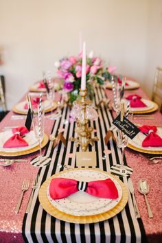 Chic striped table runner teamed with a  pink table cloth. Lauren Rae Photo