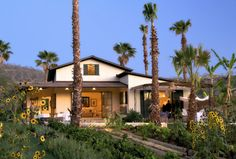 Love the outside landscaping of this mediterranean home.  Beautiful and open and lush.