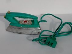 Suzy Homemaker Toy Iron by OldThingsMakeMusic on Etsy https://www.etsy.com/listing/175360067/suzy-homemaker-toy-iron