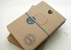 DIY notebooks with kraft paper, graph paper, stamps, staples, and rubber band.