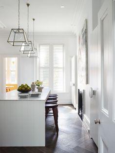 White kitchen with beautiful timber herringbone flooring. Friday's Favourites, Gallerie B blog.