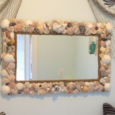Sea Shell Mirror Shells I collected from Myrtle Beach & added to an old living room mirror I had.  It now is a focal piece in our pool house bathroom that is decorated in a beach theme