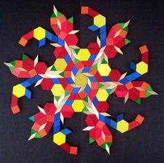 Colourful snowflakes made with wooden pattern blocks