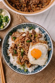 (Asian: Japanese Cuisine) Gyudon Beef and Rice Bowl- This delicious lunch features a piping hot egg, thinly sliced beef, and rice- all mixed together with a mixture of mirin and soy sauce.