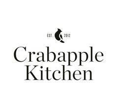 Serif logotype with waxwing bird detail designed by Swear Words for high-end café/wine bar Crabapple Kitchen.