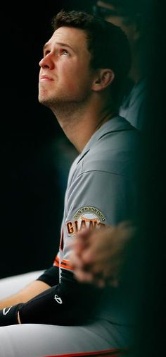 NEW YORK, NY - AUGUST 04: Buster Posey #28 of the San Francisco Giants looks on from the bench during the game against the New York Mets at Citi Field on August 4, 2014 in the Flushing neighborhood of the Queens borough of New York City.