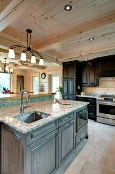 The Contrast Of The Black Cabinets Against The Wood Is So Striking And  Elegant!