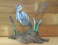 This Blue Heron is created in blue and green stained glass with free standing on a piece of driftwood.