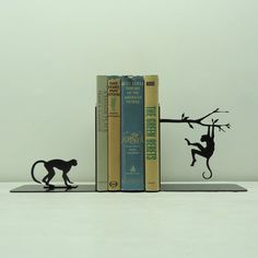 Very cool bookends, lots of different pairs. Monkey Metal Art Bookends Free USA Shipping by KnobCreekMetalArts, $62.99