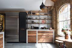 Riverwashed black walnut drawers in chic metro kitchen