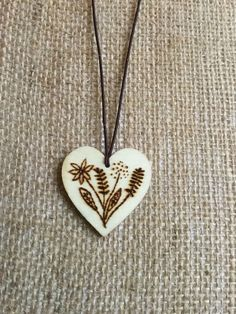 A personal favourite from my Etsy shop https://www.etsy.com/uk/listing/530312027/wild-flower-wooden-pyrography-heart