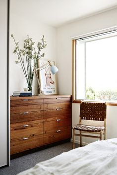 Source for dresser? Looks like Alice tacheny. Interior designer Mardi Doherty Main bedroom The master bedroom's chest of drawers is a richer take on the home's timber...