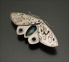 Amanda Frazier mokume moth brooch, sterling silver, copper-nickel mokume, garnets.
