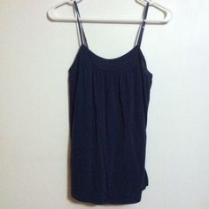 Dark blue flowy top In great condition. Bundle to save on shipping and for great deals! The more you bundle, the more you save! Just let me know how many items you'd like and I can change the bundle deal for you :) Tops Tank Tops