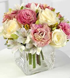 Anniversary Flowers - FTD Speak Softly Bouquet - Cream & pink roses, pastel pink lisianthus and soothing white alstroemeria softly speak your affections. Be it a special occasion, or thinking of you gift, this bouquet arranged in a glass cube vase, will express your fondest wishes.