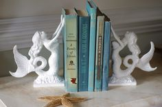 Mermaid Gift Bookend or Door Stop Lovely Little Mermaid by ByTheSeashoreDecor on Etsy https://www.etsy.com/listing/111312228/mermaid-gift-bookend-or-door-stop-lovely