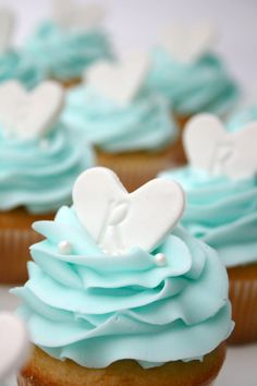 Tiffany blue color fits well with a multitude of colors and looks amazing in wedding decor. Here are some ideas of Tiffany blue wedding decorations. Wedding Shower Cupcakes, Wedding Cakes With Cupcakes, Fun Cupcakes, Cupcake Cakes, Tiffany Cupcakes, Simple Cupcakes, Wedding Cupcake Toppers, Heart Cupcakes, Fondant Cupcakes