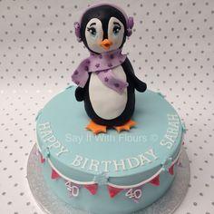 Penguin birthday cake.