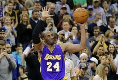 Lakers guard Kobe Bryant holds up the ball and waves to the Minnesota crowd  after passing Michael Jordan for third on the NBA all-time scoring list 8542239e89