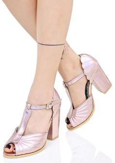 Iron Fist Mother Of Pearl Heels you're a sight for sore sea eyes, babe! These amazin' peep toe heels feature a holographic pink vegan leather construction that shinez beautiful rainbow hues, thick block heel, stitched shell details across the toe 'N heel, and adjustable T-strap buckle closure.