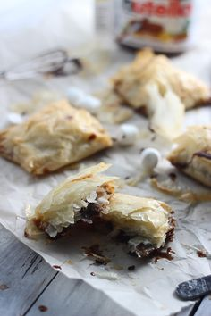Peanut Butter Nutella Phyllo Pockets. Grown up s'mores. Brush Phyllo dough with melted butter. Add Nutella, peanut butter and marshmallows. Fold and cut. Bake.