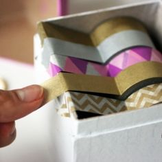 Make your own washi tape dispenser with this adorable paper mache box