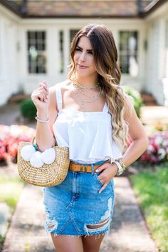 classic summer style summer fashion distressed denim skirt white tank neutral fashion denim and white fashion pom pom purse classic style peplum top marc fisher wedges camel and white denim and camel charlotte fashion blogger