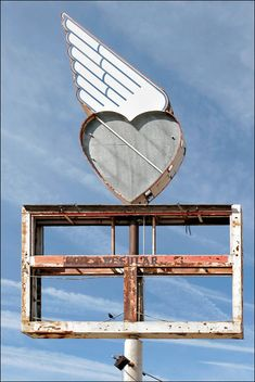 How resist a heart with wings? Ghost Sign - Tehachapi, CA 2009 by Kenneth David Geiger, via Flickr