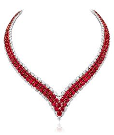 Cellini Jewelers Ruby and Diamond V Necklace Oval Burmese ruby 2-row V necklace with diamond outline. Burmese rubies totaling 107.40 carats.