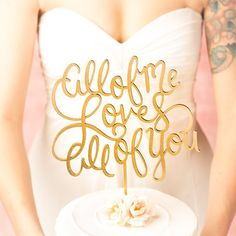 All of Me Loves All of You - Cake Topper in Gold | http://emmalinebride.com/reception/cursive-cake-toppers-gold/