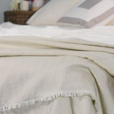 ***This item has to be ordered.  We do not have stock in this item.  Time of availability will vary due to shipping.*** The classic Herringbone Throw features a natural fringe which accentuates its elegant champagne and ivory herringbone pattern.Made in the USA and crafted from 55% Tencel +Plus™, this luxurious throw is silky and soft making it the perfect accessory for snuggling up in your designer bedding.Contents: 55% Tencel Plus, 45% CottonWidth54''Length76''Hem Width1''