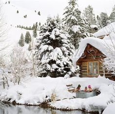 outdoor hot tub surrounded by snow