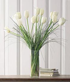Simple white french tulips. We had arrangements like this one on the altar at our wedding