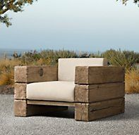 Restoration Hardware's Aspen Lounge Chair:We've interpreted the earthiness and strength of a Scandinavian artisan design by Søren Rose in the Aspen Collection. Hewn from massive timbers of French oak, every piece celebrates nature in its rustic simplicity..