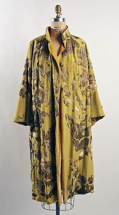 Evening coat  Date:     1930–31 Culture:     French Medium:     silk, metallic thread Dimensions:     Length at CB: 45 in. (114.3 cm) Accession Number:     1976.216.3